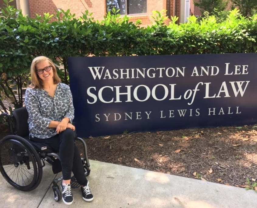 Evelyn Clark in wheel chair in front of Washington and Lee School of law sign